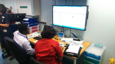 David Adeniji at the controls with one of the hospital matrons