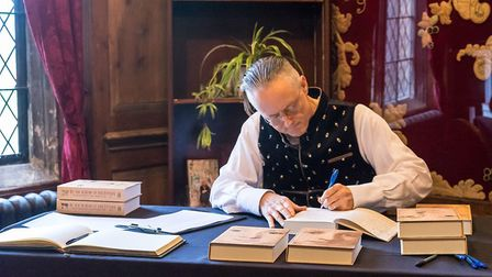 Henry Lytton Cobbold signs copies of the book. Picture: Courtesy of Henry Lytton Cobbold