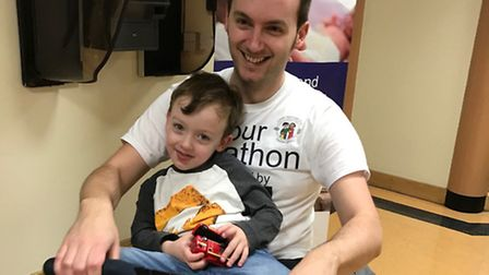 Glyn Doggett with his son Max, who was born three months early in 2013.