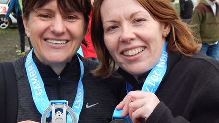 Kerry Franklin and Jayne Moss after completing the Cambridge Half Marathon on Sunday. Photo: Courtes