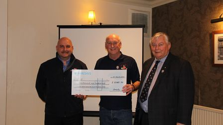 RNLI fundraising manager Terry James, branch chairman John Pearce and branch president Richard Cox.