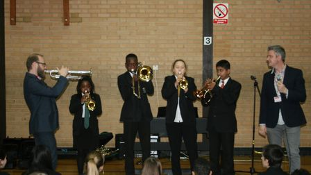 Madness trombonist Paul Fisher leads his workshop at Fearnhill School. Photo: Courtesy of Fearnhill