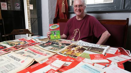 Half Moon pub landlord Howard Philips with the selection of Arsenal memorabilia from the 1960's whic