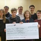 Sixth formers at Saffron Walden County High present the cheque to Open Door Counselling