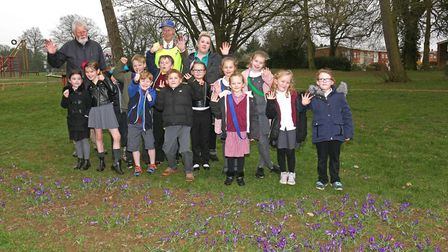 Pupils from Longmeadow school with Chris Tye and Bob Goodwin from Stevenage rotary club and the croc