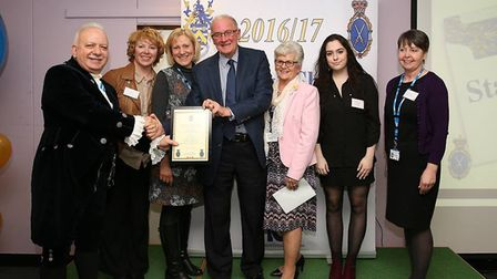 High Sheriff Stelio Stefanou presents the Stand By Me project with their commendation. Photo: CPG Ph