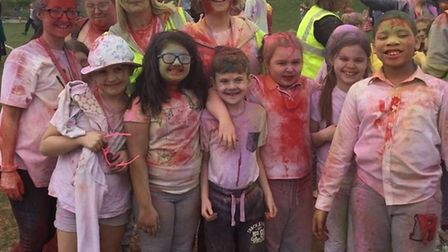 Pupils, staff and parents from Camps Hill Primary School in Stevenage get involved in a Colour Run f