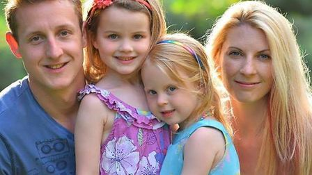 Jane, right, with her husband Andy and daughters Ruby and Jessica.