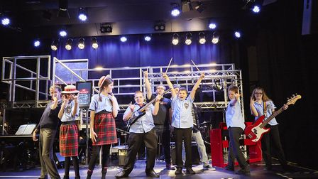 Cast members from the Valley School production of School of Rock pose with Alfie Parker, centre. Pho