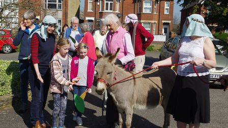 Charity the donkey helps re-enact Jesus' entry to Jerusalem in the car park of Hitchin's Tilehouse S