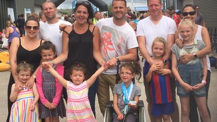 Gary Hall, Barry Rainbow and Stuart Lee with their families, including Leila Rainbow in front. Photo