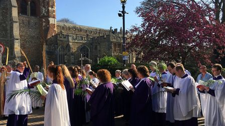 The Palm Sunday service at St Mary's Church in Hitchin, with Canon Michael Roden and Rev Dan Drew le
