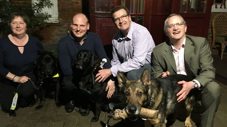 Sean Dilley (second from left) organised the Guide Dogs Stevenage curry night at the Raj Mahal, whic