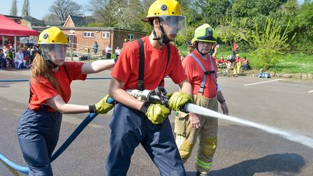 Fire cadets with a hosereel during the competition. Picture: Beds Fire and Rescue