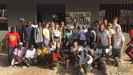 The team of volunteers with the children and staff from the school in Kassa Kunda