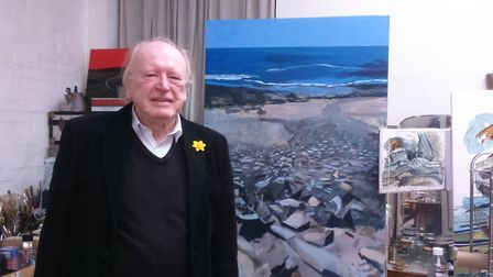 Peter Blagg next to his latest painting based on the Cornish coast.