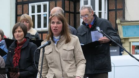 Rev Jane Mainwaring of St Mark's Church leads Hitchin's united Good Friday service in Market Place.