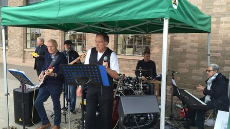 The Praise Be Band play outside Baldock's Tesco store with Councillor Jim McNally on vocals, as Rev