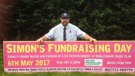 Simon with the banner for the Rugby fundraising day.