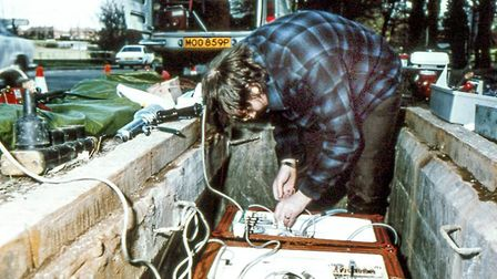 David Dalgoutte aligning the optical connectors on an optical regenerator, in a footway box somewher
