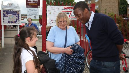 Hitchin and Harpenden conservative candidate Bim Afolami speaks to Jean Deller and great granddaught