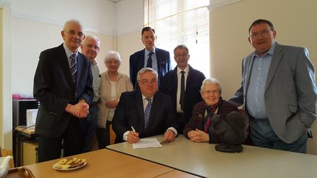 Sir Oliver Heald signs up for the Black Squirrel Credit Union in Letchworth. Left to right: Martin S