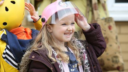 A girl wearing a pink fireman's hat at the Baldock fire station open day. Picture: Danny Loo