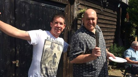 Great Wall Marathon runner Robert Hegarty, left, with White Hart pub landlord Yos Levi. Picture: Rob