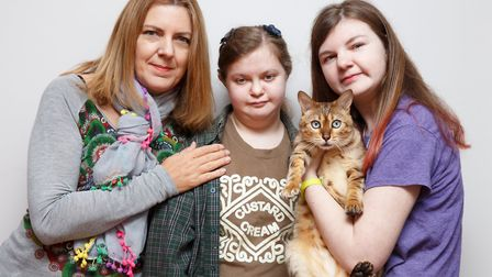 Sharon Cooper with daughters Pearl, 17, Verity, 19, and Rosie the cat.