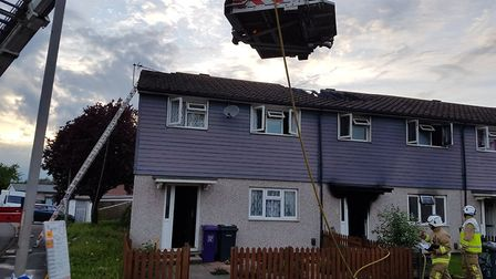 Firefighters from Baldock, Hitchin, Stevenage and Welwyn Garden City work to tackle the house fire i
