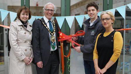 Tom and outgoing North Herts District Council chairman John Booth cut the ribbon at Nanny Julies wit