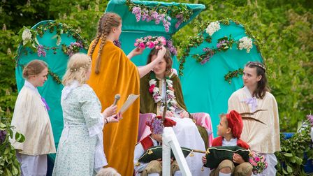 Ickwell May Queen Kayleigh Henegan is crowned by last year's queen Lucy Menheneott. Picture: Darren