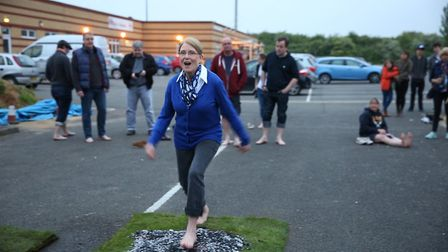 Helen Bardell walks over hot embers in aid of St Peter's Church of Arlesey. Picture: Jodie Chillery