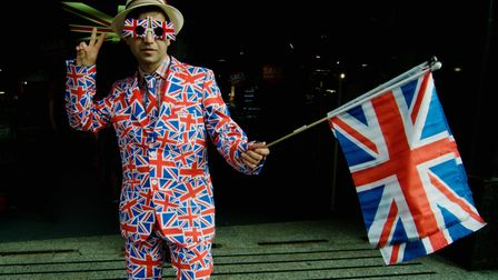 A man wearing a costume in the colors of the United Kingdom flag as Britain voted for Brexit