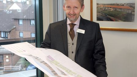 Howard Cottage Housing Association chief executive John Welch with the Hamonte plans, with a photo o
