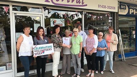 The Living Room Hertfordshire is acknowledging its legion of helpers - pictured here outside the cha