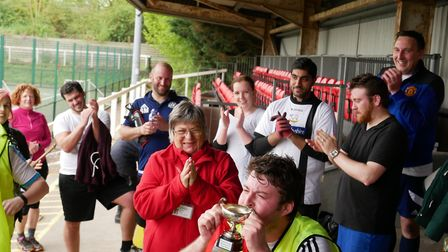 Team Metro lifting the trophy at the DisplayPlan charity football day in aid of Essex & Herts Air Am