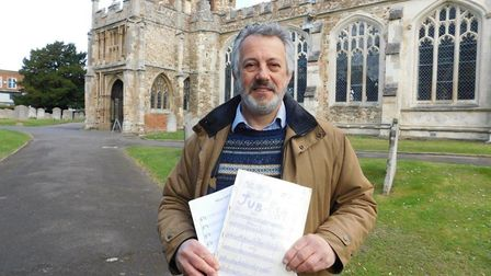 Andrew Weight outside St Mary's on Monday with an original score of Silver Jub-Elation and a new cop