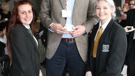 Professional basketball player and former Fearnhill pupil Zak Wells with two students on his return
