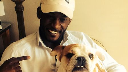 Yale-bound: Dr John Ndikum pictured with friend Jonathan Rhodes' bulldog George. Jonathan is current
