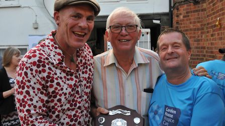 Gary Ryall, Councillor Michael Muir and quizmaster Simon Jellis with the quiz trophy. Picture: JP As