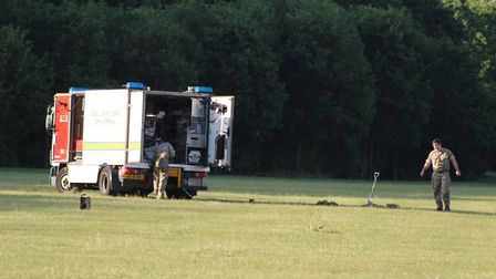 The bomb disposal team about to carry out the controlled explosion at Fairlands Valley Park in Steve