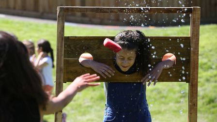Punters throw wet sponges at people in stocks at the William Ransom summer fete. Picture: Danny Loo