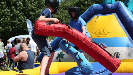 Children play on inflatables at the William Ransom summer fete. Picture: Danny Loo