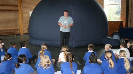 Pupils look at the University of Hertfordshire's inflatable planetarium at Fearnhill School in Letch