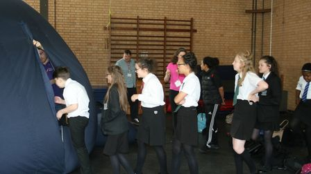 Fearnhill pupils troop into the University of Hertfordshire's inflatable planetarium. Picture: Fearn