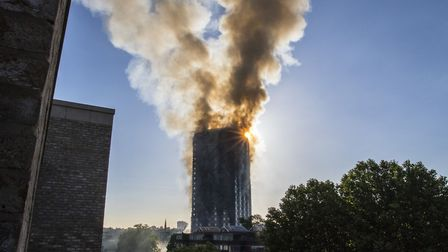 Smoke billows from the fire that has engulfed Grenfell Tower in west London. Picture: Rick Findler/P