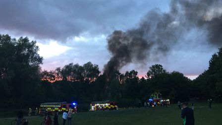 Firefighters tackling the fire in Fairlands Valley Park, Stevenage. Picture: Danny Loo