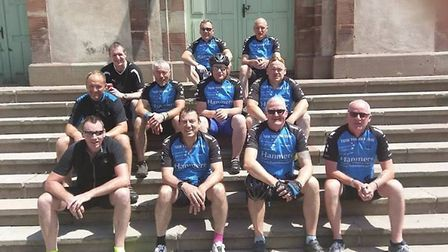 The inspirational Twin Town cyclists in France on the final stage of their gruelling ride