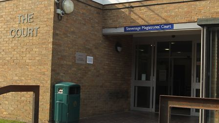 A violent repeat offender from Stevenage who continued beating a woman despite being threatened with